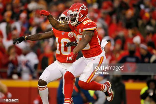 Damien Williams and Tyreek Hill of the Kansas City Chiefs celebrate a touchdown by Blake Bell not pictured in the fourth quarter of the AFC...
