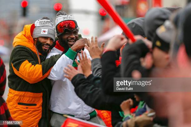 Damien Williams of the Kansas City Chiefs and Jordan Lucas of the Kansas City Chiefs greet Kansas City Chiefs fans on February 5 2020 in Kansas City...