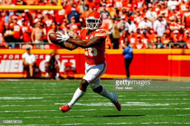 Damien Williams of the Kansas City Chiefs catches a pass after a bobble during the second quarter of the game against the San Francisco 49ers at...