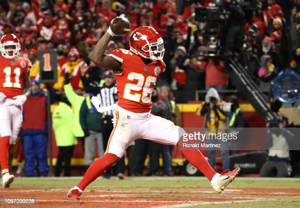 Damien Williams of the Kansas City Chiefs celebrates after rushing for a 2yard touchdown in the fourth quarter against the New England Patriots...