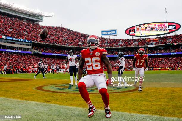 Damien Williams of the Kansas City Chiefs celebrates his 17-yard touchdown reception against the Houston Texans during the second quarter in the AFC...
