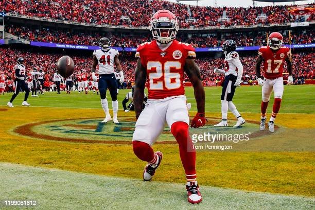 Damien Williams of the Kansas City Chiefs celebrates his 17yard touchdown reception against the Houston Texans during the second quarter in the AFC...