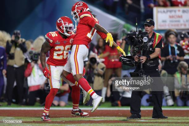 Damien Williams of the Kansas City Chiefs celebrates with Demarcus Robinson after a touchdown against the San Francisco 49ers during the fourth...