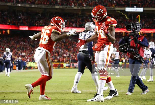 Damien Williams of the Kansas City Chiefs celebrates with Demetrius Harris after catching a 1yard touchdown pass in the fourth quarter during the AFC...