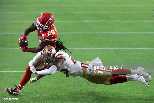 Damien Williams of the Kansas City Chiefs dives into the endzone for a touchdown against the San Francisco 49ers during the fourth quarter in Super...