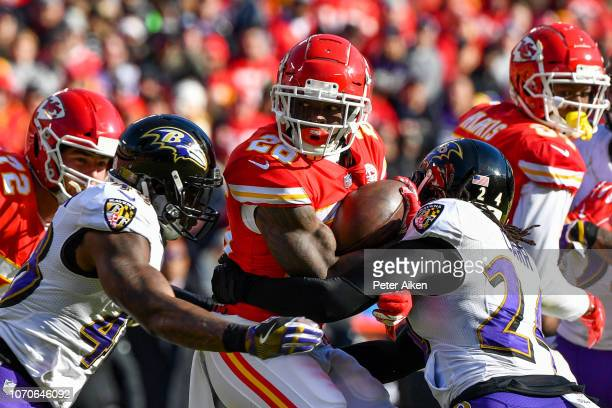 Damien Williams of the Kansas City Chiefs fights for extra yardage on a rush during the second quarter of the game against the Baltimore Ravens at...