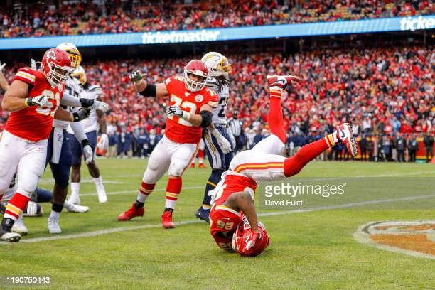 Damien Williams of the Kansas City Chiefs flipped in the end zone during his 7yard fourth quarter touchdown run against the Los Angeles Chargers at...