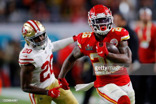 Damien Williams of the Kansas City Chiefs gives a stiff arm to of the San Francisco 49ers during the fourth quarter in Super Bowl LIV at Hard Rock...