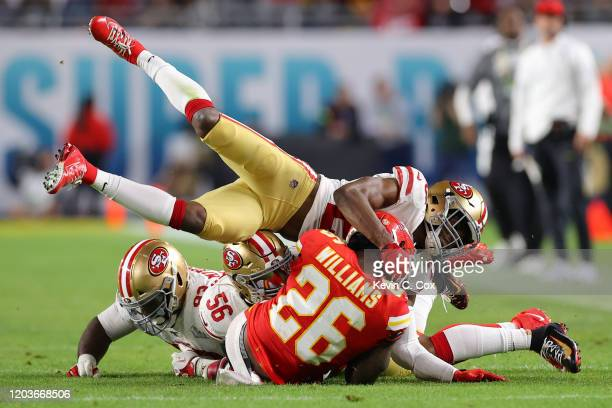 Damien Williams of the Kansas City Chiefs is tackled against the San Francisco 49ers in Super Bowl LIV at Hard Rock Stadium on February 02 2020 in...