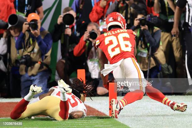 Damien Williams of the Kansas City Chiefs is tackled by Richard Sherman of the San Francisco 49ers in Super Bowl LIV at Hard Rock Stadium on February...