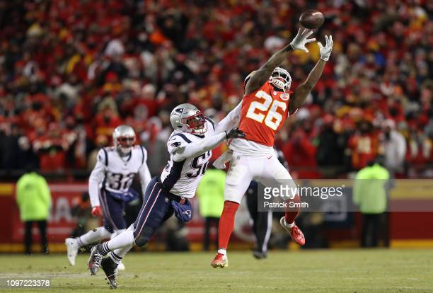 Damien Williams of the Kansas City Chiefs jumps for a catch against Elandon Roberts of the New England Patriots in the second half during the AFC...