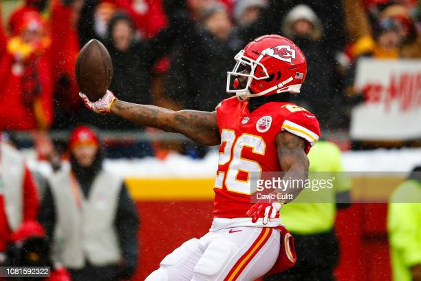 Damien Williams of the Kansas City Chiefs presents the ball to the crowd after scoring the game's first touchdown during the first quarter of the...