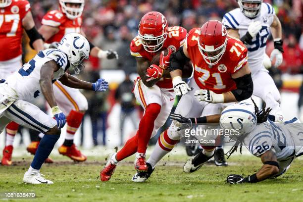 Damien Williams of the Kansas City Chiefs runs behind the block of teammate Mitchell Schwartz against the Indianapolis Colts during the first quarter...