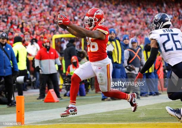 Damien Williams of the Kansas City Chiefs runs for a three yard touchdown in the fourth quarter against the Tennessee Titans in the AFC Championship...