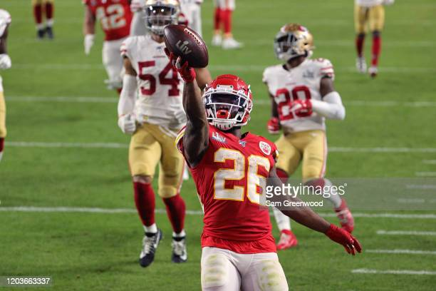 Damien Williams of the Kansas City Chiefs runs for a touchdown against the San Francisco 49ers during the fourth quarter in Super Bowl LIV at Hard...
