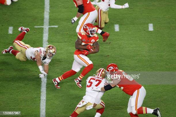 Damien Williams of the Kansas City Chiefs runs with the ball against the San Francisco 49ers during the first quarter in Super Bowl LIV at Hard Rock...