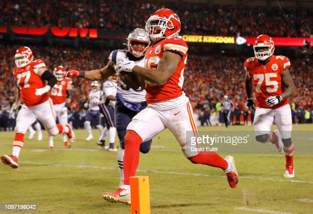 Damien Williams of the Kansas City Chiefs runs with the ball on his way to scoring a 23yard receiving touchdown in the fourth quarter against the New...