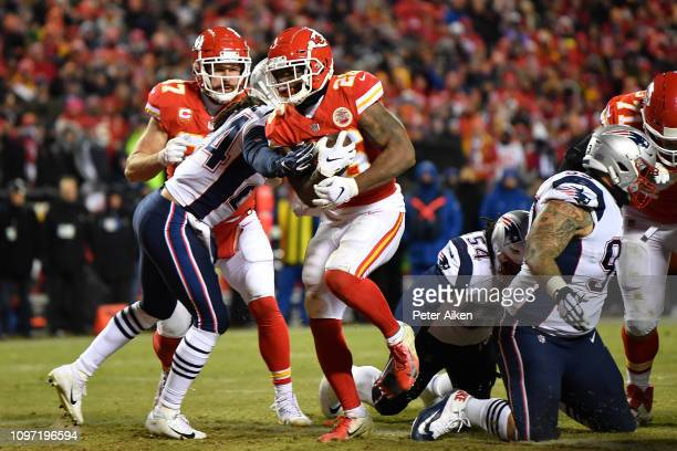 Damien Williams of the Kansas City Chiefs rushes for a 2yard touchdown in the fourth quarter against the New England Patriots during the AFC...