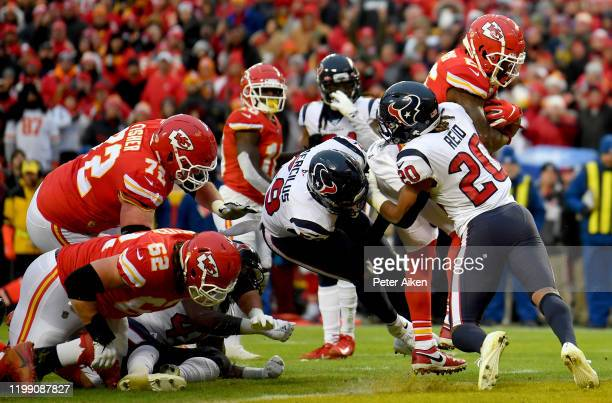 Damien Williams of the Kansas City Chiefs rushes for a touchdown over Justin Reid of the Houston Texans in the third quarter of the AFC Divisional...