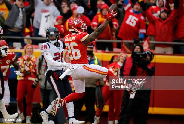 Damien Williams of the Kansas City Chiefs scores a touchdown in the second quarter of the AFC Divisional playoff game against the Houston Texans at...
