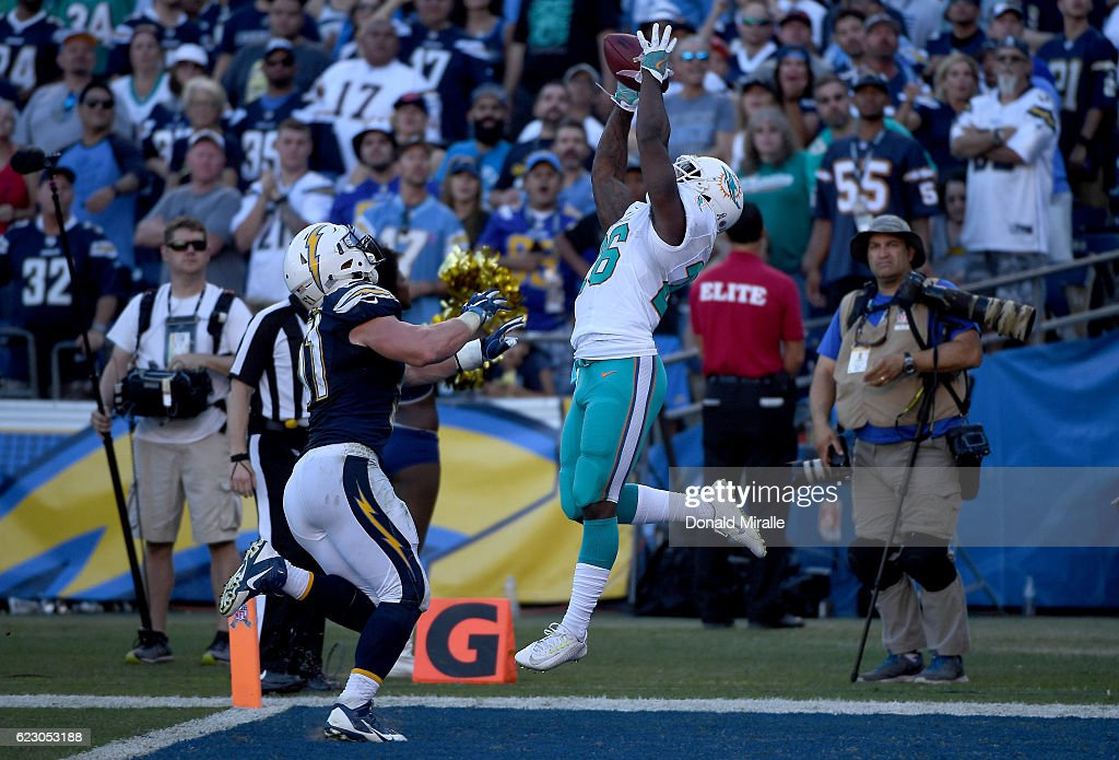 Damien Williams #26 of the Miami Dolphins catches the ball in the end zone for a touchdown against the San Diego Chargers during the second half at Qualcomm Stadium on November 13, 2016 in San Diego, California.