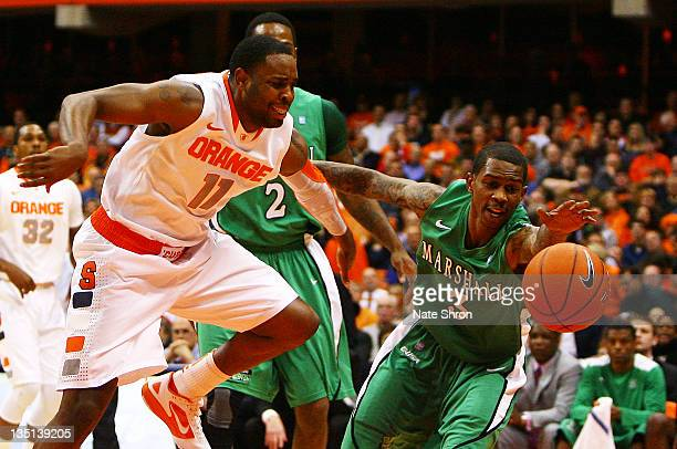 Damier Pitts of the Marshall Thundering Herd reaches for the ball as Scoop Jardine of the Syracuse Orange chases during the game at the Carrier Dome...