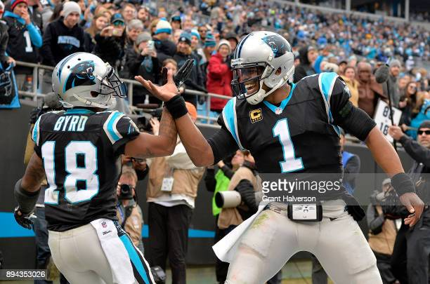 Damiere Byrd celebrates with teammate Cam Newton of the Carolina Panthers after a touchdown against the Green Bay Packers in the fourth quarter...