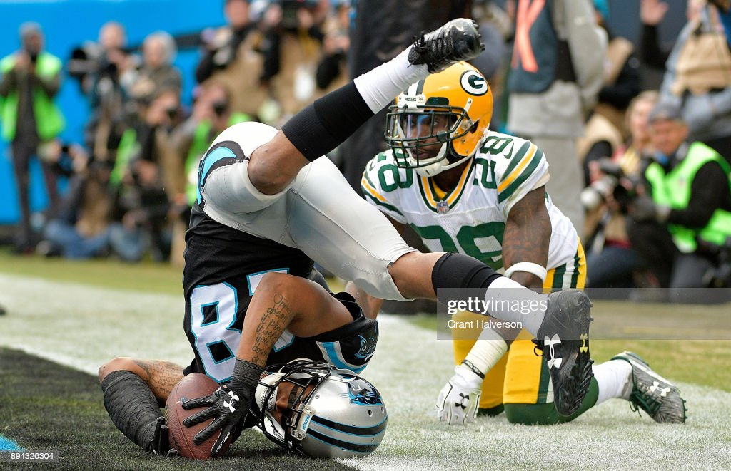 Damiere Byrd #18 of the Carolina Panthers catches a touchdown pass against Josh Hawkins #28 of the Green Bay Packers in the third quarter during their game at Bank of America Stadium on December 17, 2017 in Charlotte, North Carolina.