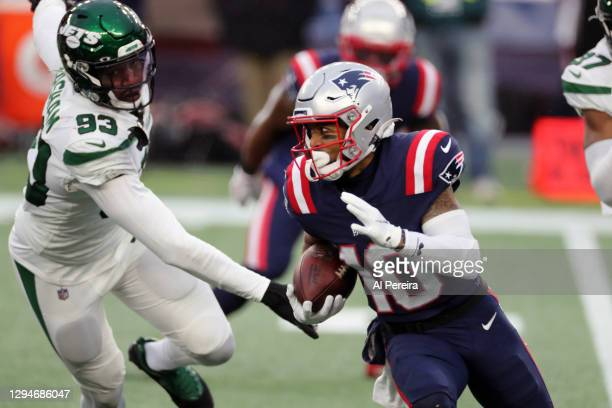 Damiere Byrd of the New England Patriots has a long gain against the New York Jets at Gillette Stadium on January 3, 2021 in Foxborough,...