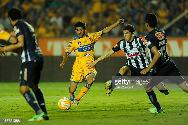 Damián Álvarez hits the ball during the match between Tigres and Monterrey as part of the Clausura 2013 Tournament on April 27 2013 in Monterrey...