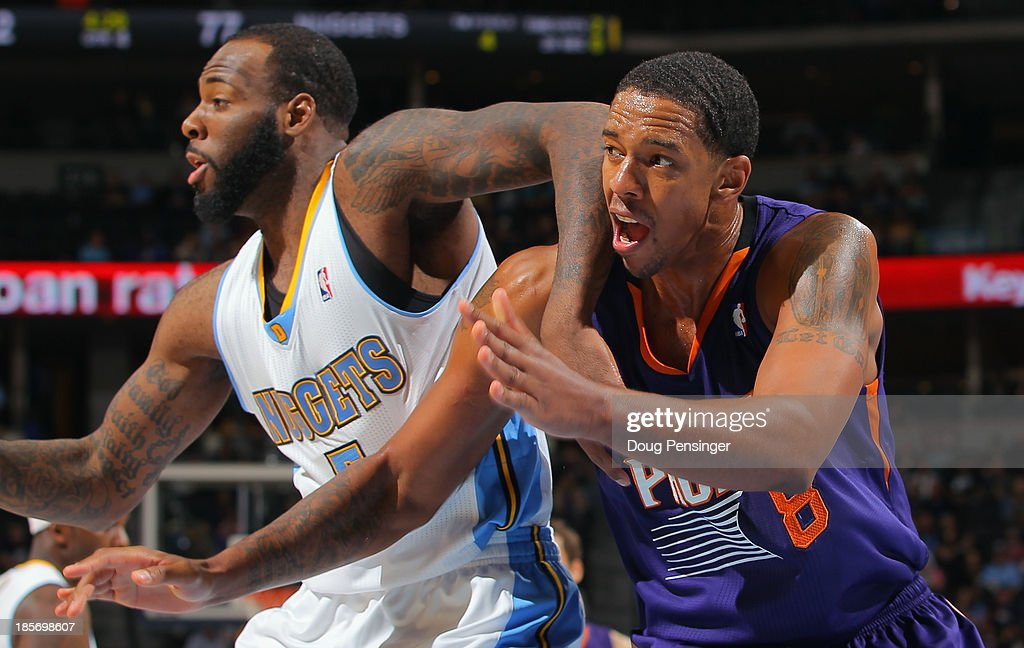 Damion James #5 of the Denver Nuggets and Channing Frye #8 of the Phoenix Suns battle for rebounding position during preseason action at Pepsi Center on October 23, 2013 in Denver, Colorado. The Suns defeated the Nuggets 98-79.