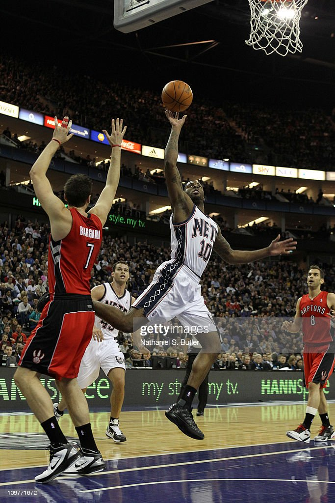 Damion James #10 of the New Jersey Nets gets past and shoots over Andrea Bargnani #7 of the Toronto Raptors during their game at the O2 Arena on March 4, 2011 in London, England.