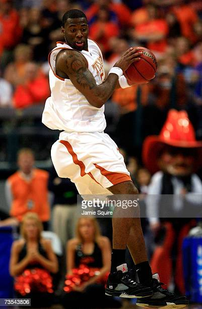 Damion James of the Texas Longhorns tries to control the ball during the semifinal game of the Phillips 66 Big 12 Men's Basketball Championship...
