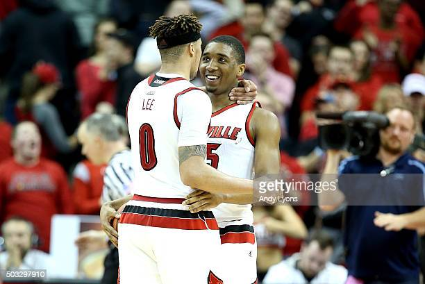 Damion Lee and Donovan Mitchell of the Louisville Cardinals celebrate after the 6557 win over the Wake Forest Demon Deacons at KFC YUM Center on...