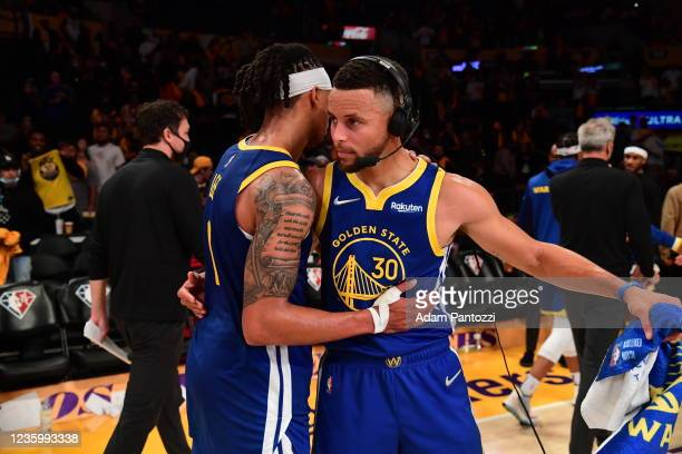 Damion Lee and Stephen Curry of the Golden State Warriors hug after the game against the Los Angeles Lakers on October 19, 2021 at STAPLES Center in...