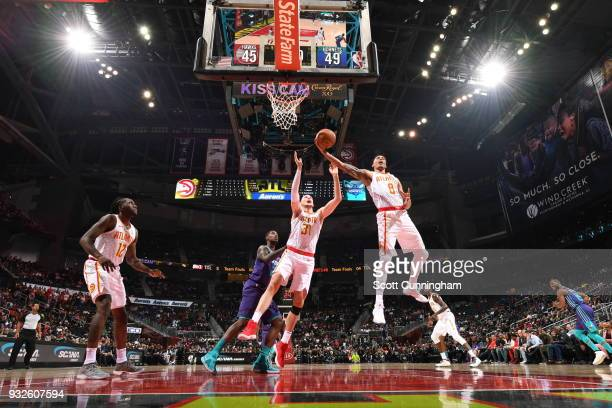 Damion Lee of the Atlanta Hawks grabs the rebound against the Charlotte Hornets on March 15 2018 at Philips Arena in Atlanta Georgia NOTE TO USER...