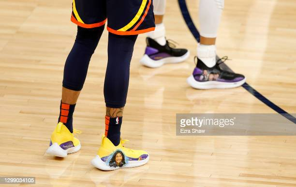 Damion Lee of the Golden State Warriors of the Golden State Warriors wears custom Under Armour sneakers with a picture of Kobe Bryant and his...