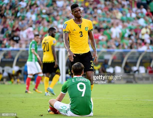 Damion Lowe of Jamaica reacts after a collision with Erick Torres of Mexico during the first half of the CONCACAF 2017 semifinal at Rose Bowl on July...