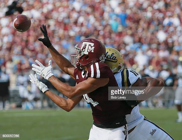 Damion Ratley of the Texas AM Aggies has a pass intended for him deflected by Fabian Moreau of the UCLA Bruins on September 3 2016 in College Station...
