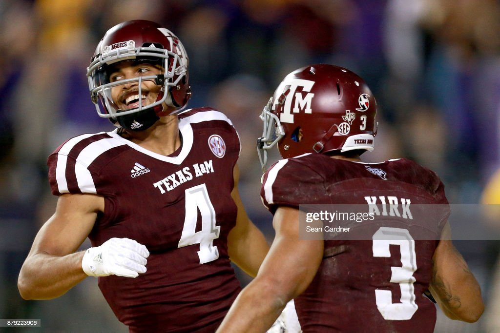Damion Ratley #4 of the Texas A&M Aggies reacts with Christian Kirk #3 of the Texas A&M Aggies after scoring a touchdown against the LSU Tigers during the second half of a game at Tiger Stadium on November 25, 2017 in Baton Rouge, Louisiana. LSU won the game 45 - 21.