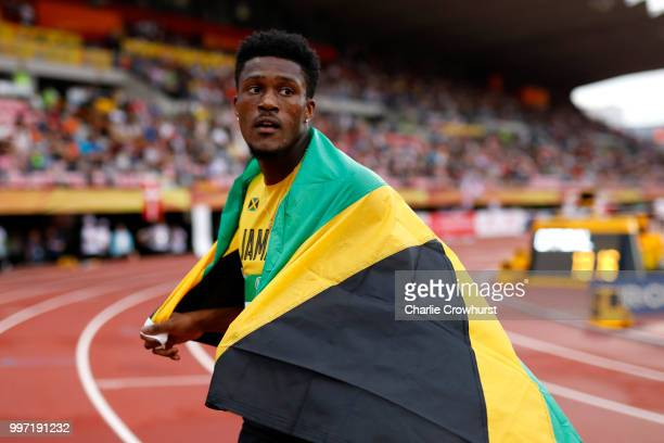 Damion Thomas of Jamaica celebrates after winning gold in the final of the men's 110m hurdles during the XX on day three of The IAAF World U20...