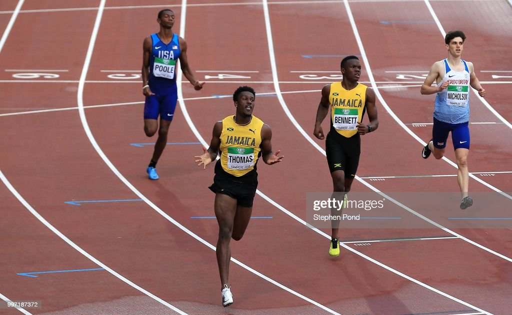 Damion Thomas of Jamaica celebrates as he crosses the line to win gold in the final of the men's 110m hurdles during the XX on day three of The IAAF World U20 Championships on July 12, 2018 in Tampere, Finland.