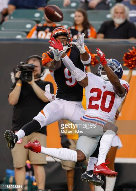 Damion Willis of the Cincinnati Bengals goes up for the passed ball as Janoris Jenkins of the New York Giants defends during the preseason game at...
