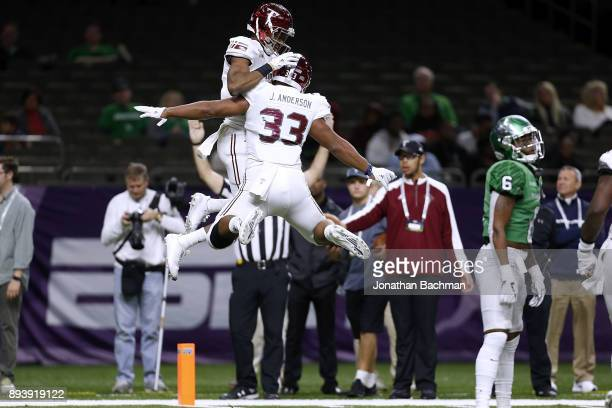 Damion Willis of the Troy Trojans celebrates a touchdown with Josh Anderson during the first half of the RL Carriers New Orleans Bowl against the...