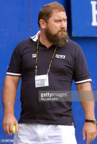 Damir Dokic father of rising Australian tennis player Jelena Dokic watches his daughter train at the Australian Open in Melbourne 20 January 2000...