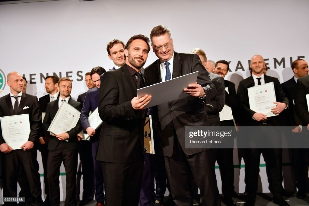 Damir Dugandzic gets his certificate as new football coach from DFB president Reinhard Grindel (R) during the 'Coaching Award Ceremony & Closing Event UEFA Pro Coaching Course 2016/2017' on March 20, 2017 in Neu Isenburg, Germany.