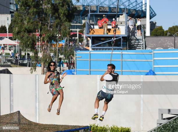 Damir Dzumhur of Bosnia and girlfriend Dejana Zivkovic take a ride on the zip wire at AO Ball Park during day four of the 2018 Australian Open at...