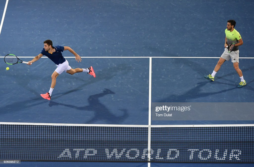 Damir Dzumhur of Bosnia and Herzegovina and Filip Krajinovic of Serbia in action during their semi final match against Jamie Cerretani of United States and Leander Paes of India on day five of the ATP Dubai Duty Free Tennis Championships at the Dubai Duty Free Stadium on March 2, 2018 in Dubai, United Arab Emirates