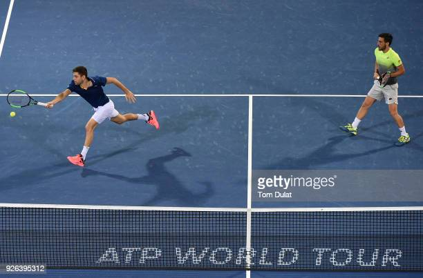 Damir Dzumhur of Bosnia and Herzegovina and Filip Krajinovic of Serbia in action during their semi final match against Jamie Cerretani of United...