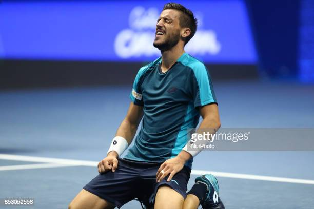 Damir Dzumhur of Bosnia and Herzegovina celebrates his victory over Fabio Fognini of Italy in the St Petersburg Open ATP tennis tournament final...